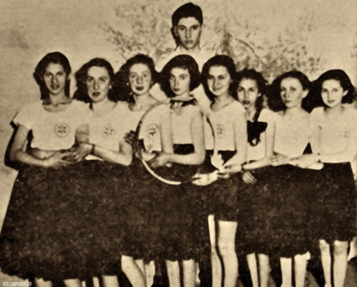 "A group of girls from Makabi on a gymnastic show in the theater together with instructor D. Lichtensztajn, Płock, 1938 (source: Yizkor Book, Plotzk - A History of an Ancient Jewish Community in Poland, published by Eliyahu Eisenberg, ""Hamenora"" Publishing House, Tel Aviv 1967)"