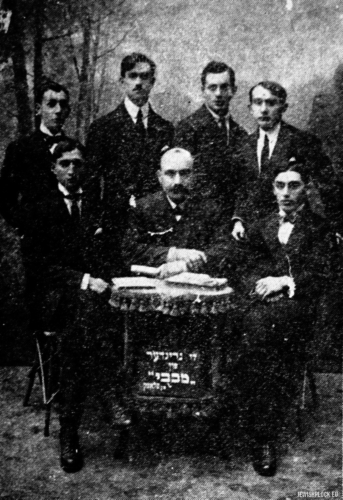 "The founders of the Makabi club. From the right: J. Pszenica, L. Goldberg, K. Hazen; standing: M. Płońskier, W. Mariensztras, Berek Zeligman, Jakub Penson. (source: Yizkor Book, Plotzk - A History of an Ancient Jewish Community in Poland, published by Eliyahu Eisenberg, ""Hamenora"" Publishing House, Tel Aviv 1967)"