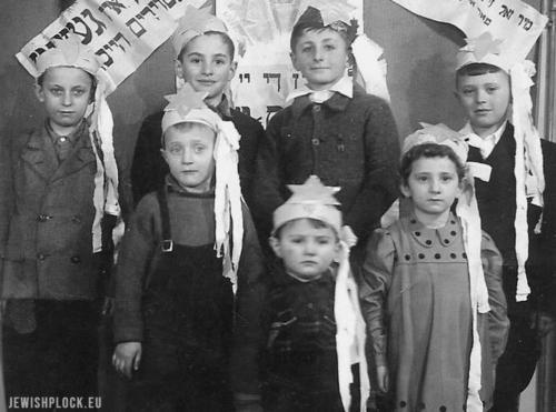 The children of the first survivors who came to Płock in 1945 celebrating Hanukkah
