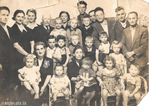 Children of the kindergarten with their teacher (sitting in the middle) with the leader of the community Alfred Blay (standing fifth from left) and some adults